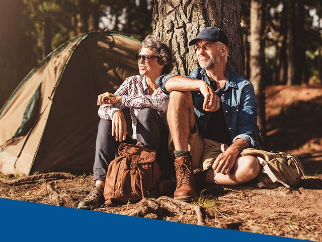 Older couple enjoying the outdoors on a camping trip