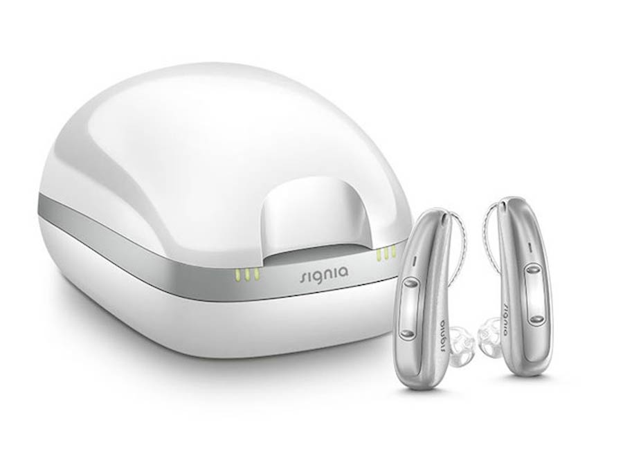 Signia Pure Charge&Go X hearing aids and charging station