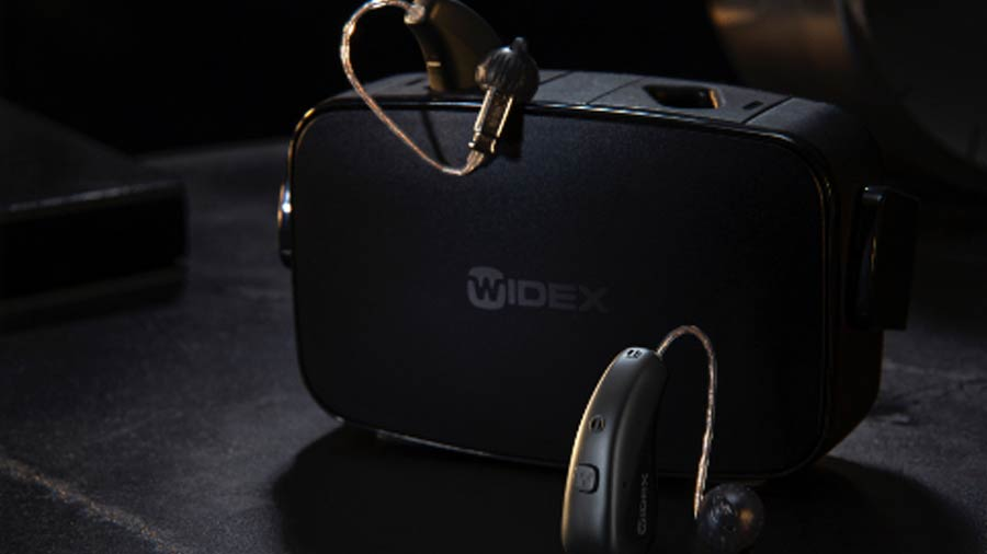 Widex Moment hearing aids in charging case