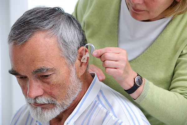 A man being fitted for a hearing aid