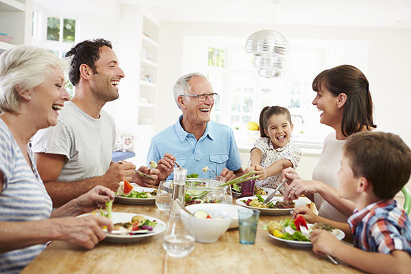 A group of people having a laugh while eating